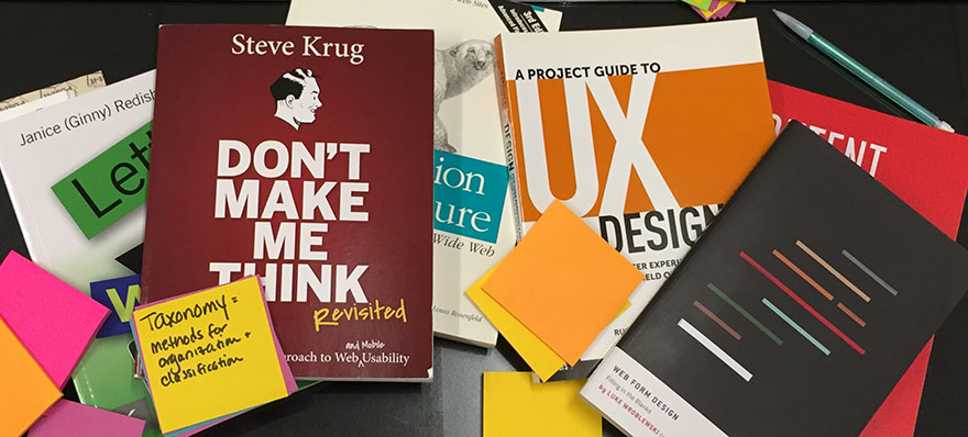 UX books and sticky notes