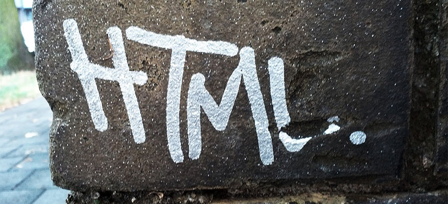 Photo of the word HTML written in graffiti